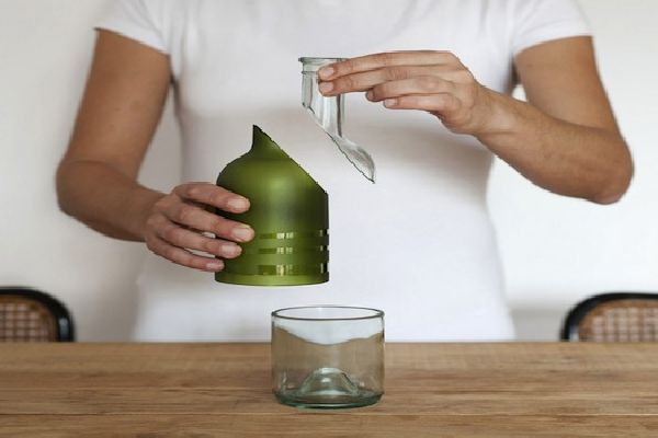 A Wine Bottle That Can Be Recycled Into Three Useful Objects