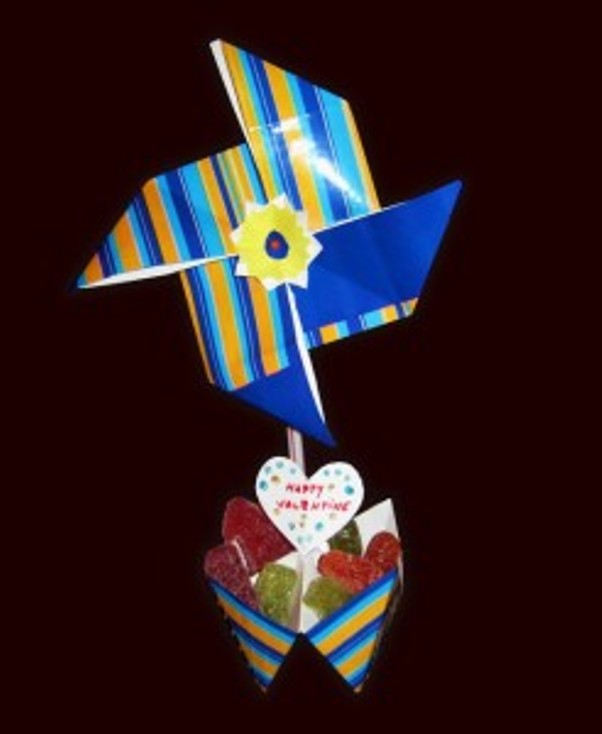 A pinwheel with a straw candy stand