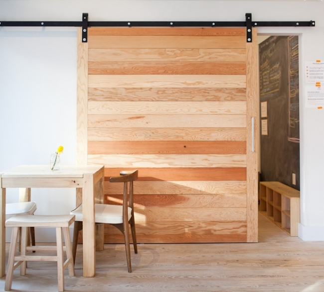 Barn doors add wood to it and make it look richer and eco for Eco friendly doors