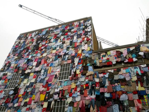 Building covered in old clothes