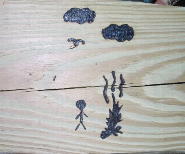 Engraved wood with Sun laser