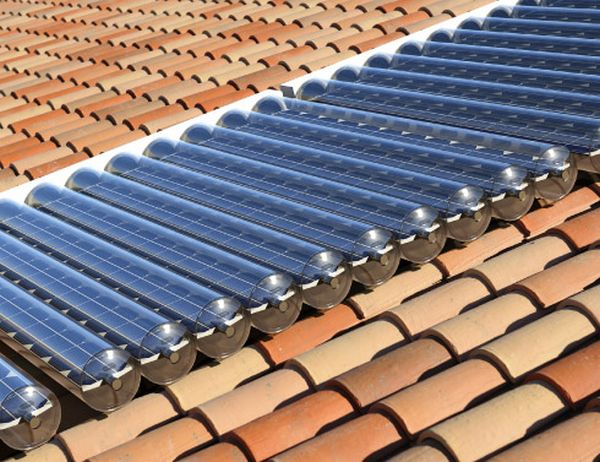 Hybrid solar panel heats water while generating electricity