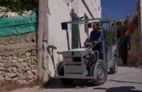 palestinian man with homemade electric car
