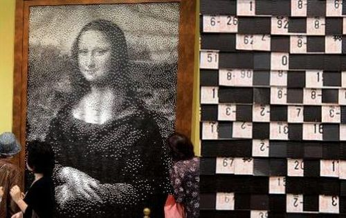 reproduction of mona lisa using old train tickets