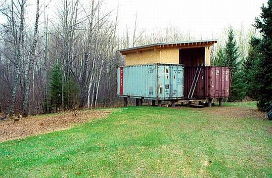Old shipping containers tuned into eco friendly cabin for Shipping container pier foundation