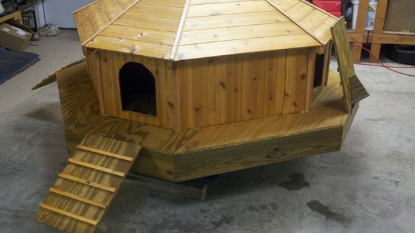 diy 'floating duck palace' has a solar powered light - ecofriend