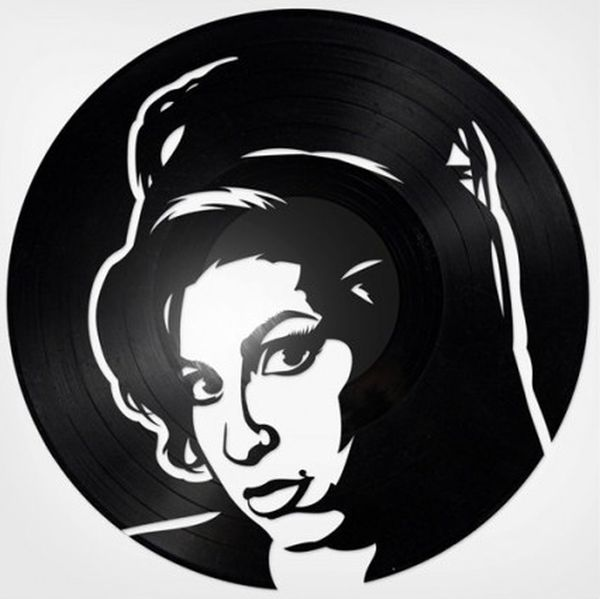 Repurposed vinyl record portraits of iconic musicians ...