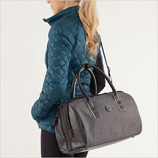 young-woman-carrying-a-gray-duffle-bag
