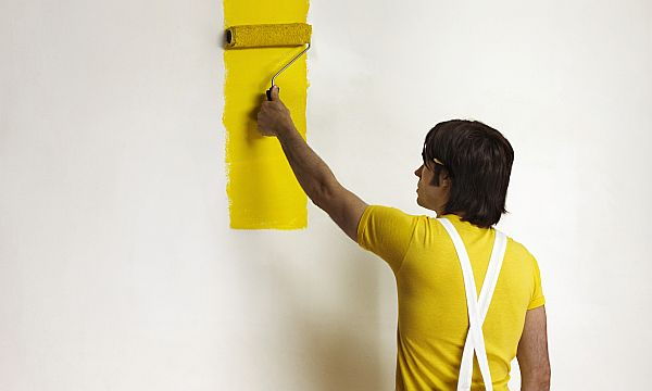 Young Man Painting Wall