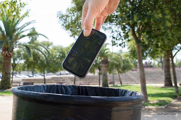 throwing mobile in bin