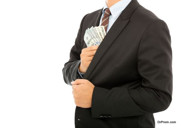 Businessman putting money in the pocket