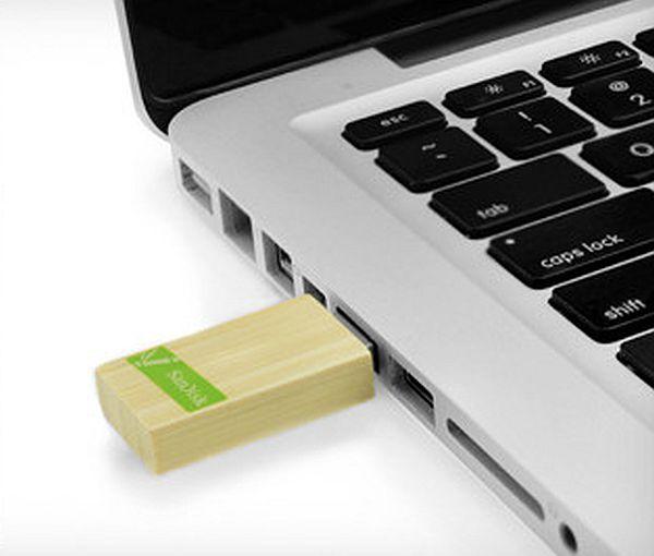 The SanDisk flash drive has a bamboo encasement,