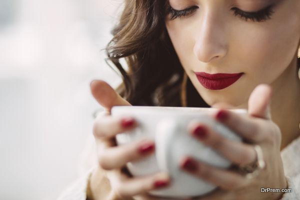 Young girl drinking coffee in a trendy cafe