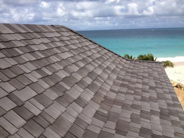 Roofs made using recycled shingles