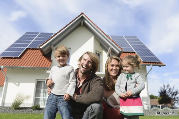 Mid adult man and family sitting on lawn of new house