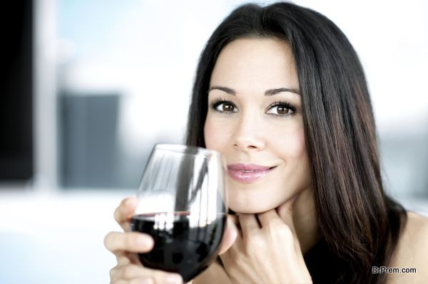 Young Woman Bartender with Red Wine Glasses