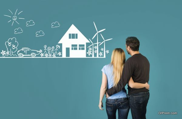 Eco house concept. Happy embracing couple looking at eco friendly house sketch.