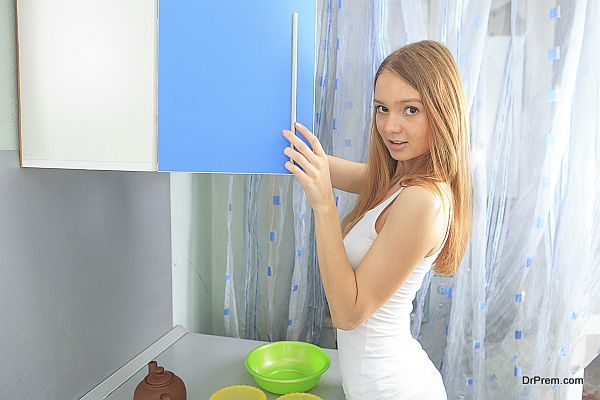 Very beautiful girl opened the cupboard