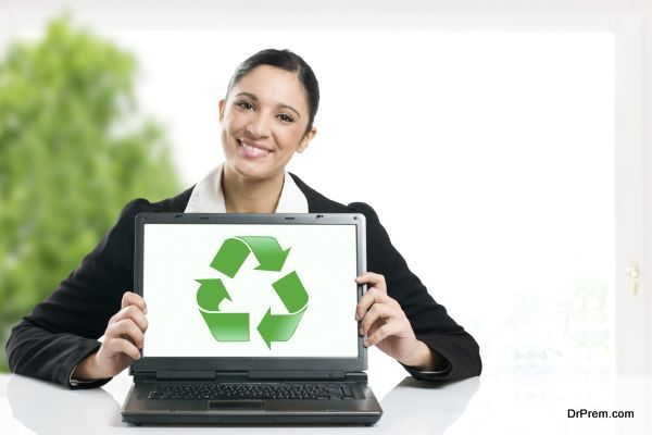 Business woman showing recycling green symbol in her laptop monitor, copy space for your text