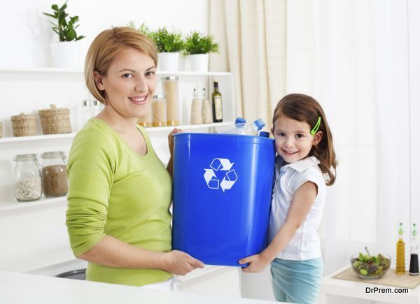 Mother and daughter recykling at home