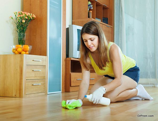 woman rubbing wooden floor