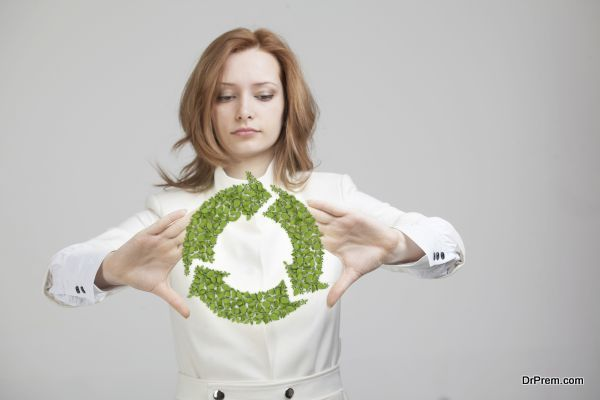 woman holding recycle symbol in his hands