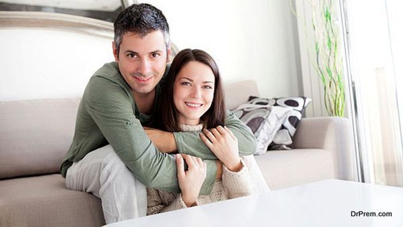 Handsome young couple at home