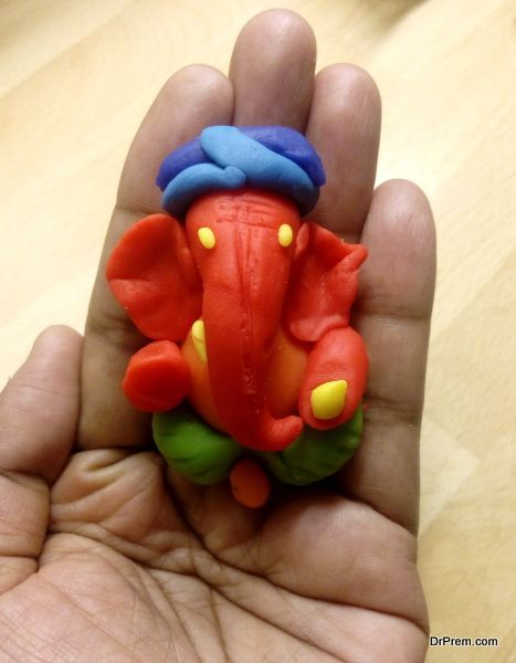 Ganesha idol in hand made of clay