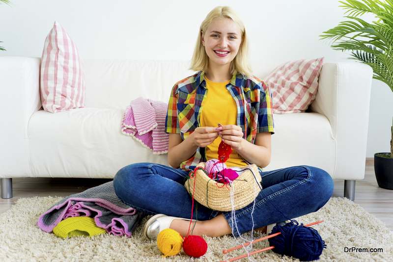 Girl knitting at home