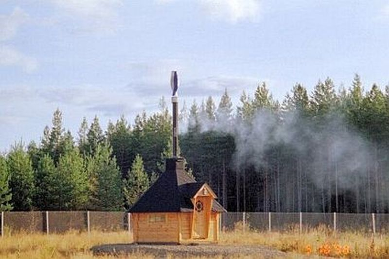 Vertical axis wind turbine that doubles as a chimney