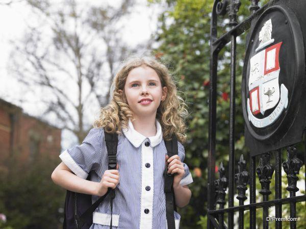 girl walking towards school