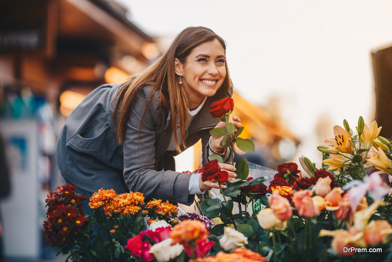 woman looking at Beautiful flowers