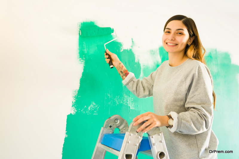 woman-using-low-Volatile-Organic-Compound-paint