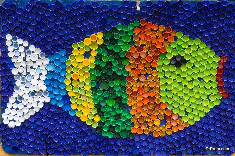 Fish mosaic deocoration made of cororful plastic bottle caps