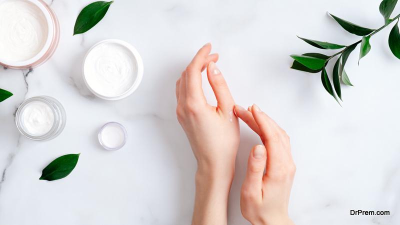 Woman applying organic moisturizing hand cream