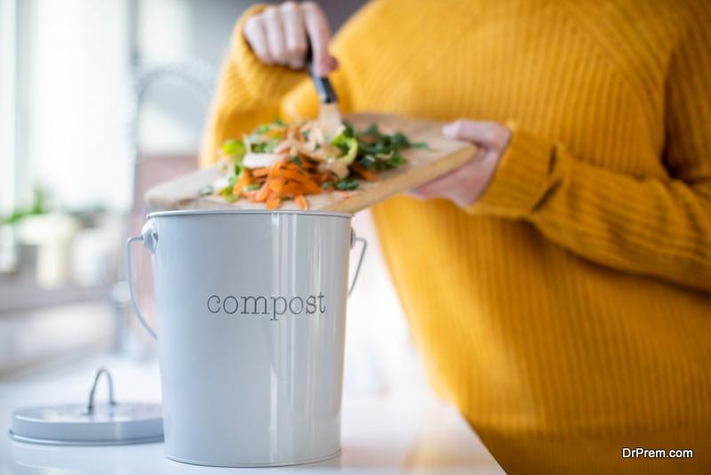 woman using Compost Bin